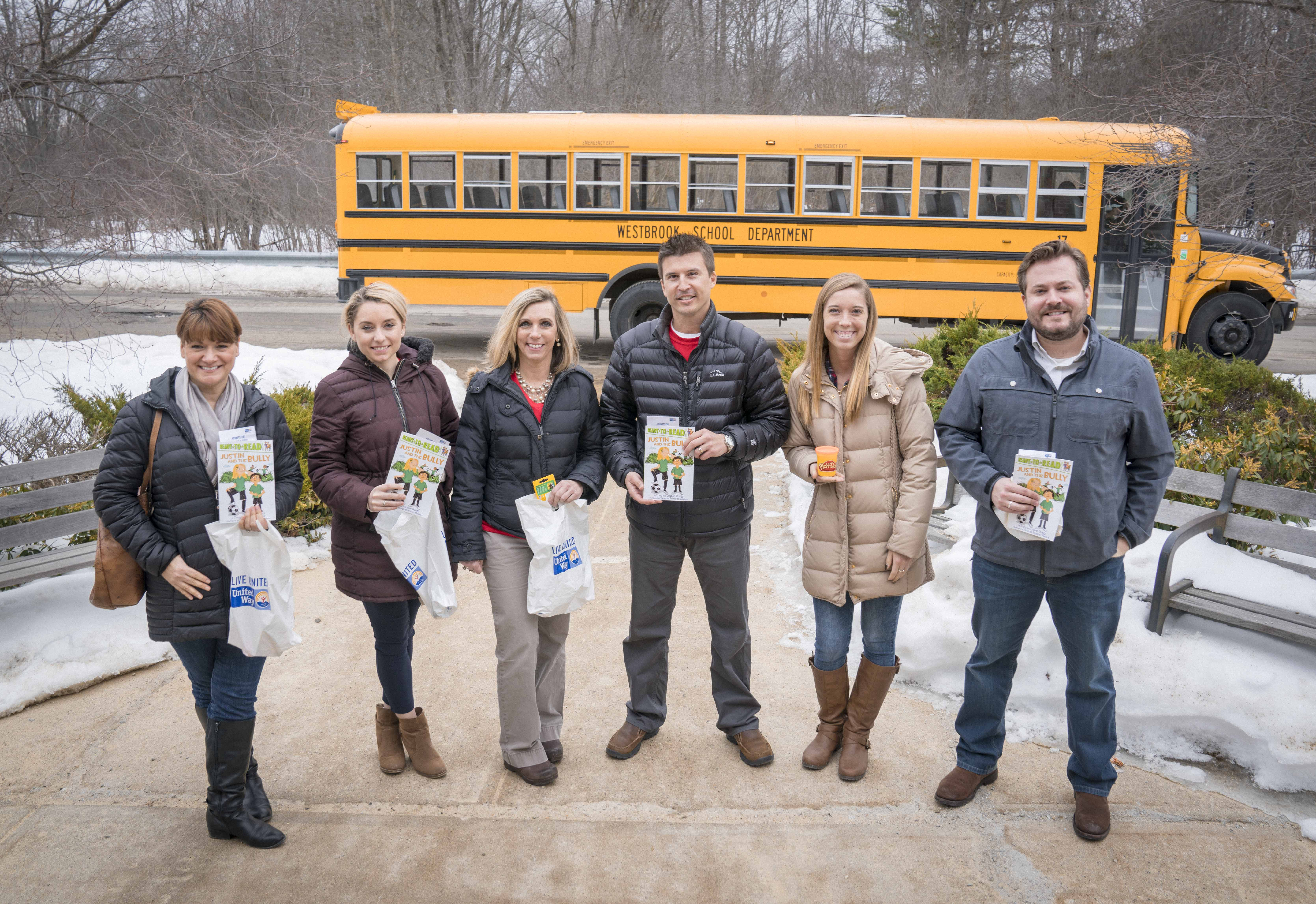 Volunteers delivering literacy kits