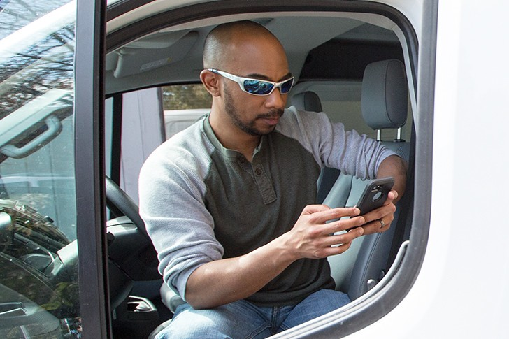 Truck driver using a WEX mobile app.