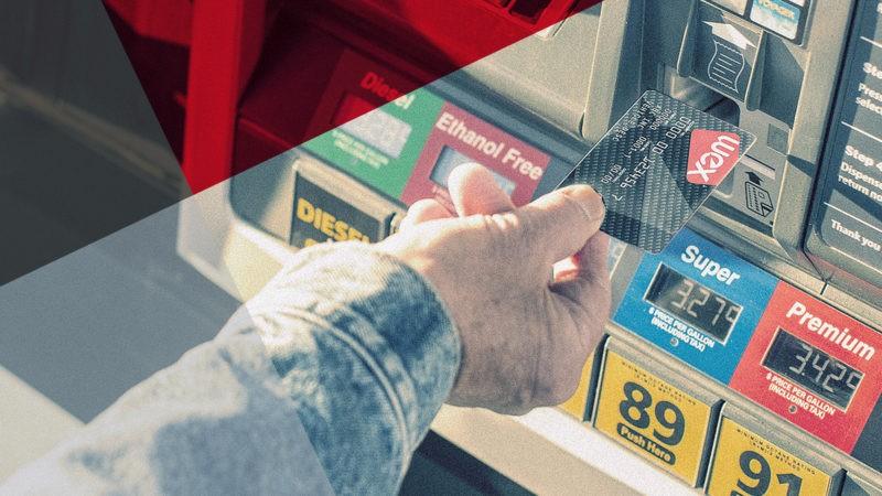 man uses fleet card at pump