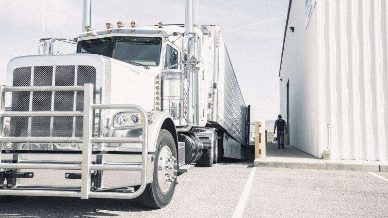 trucker walks into loading dock