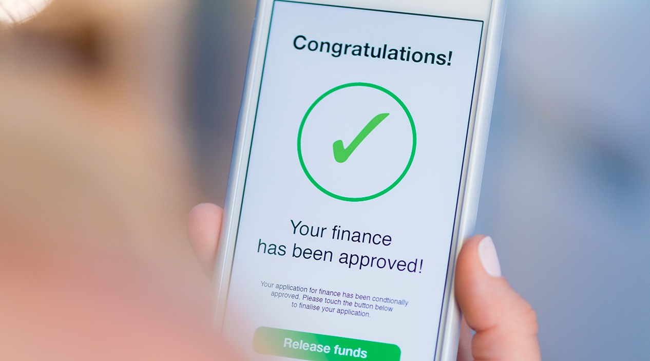 mobile phone shows approval of loan message