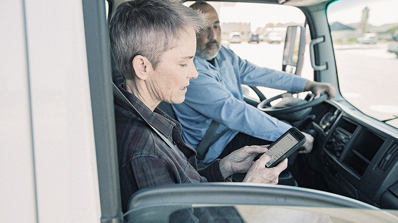 fleet drivers use mobile device in van cab