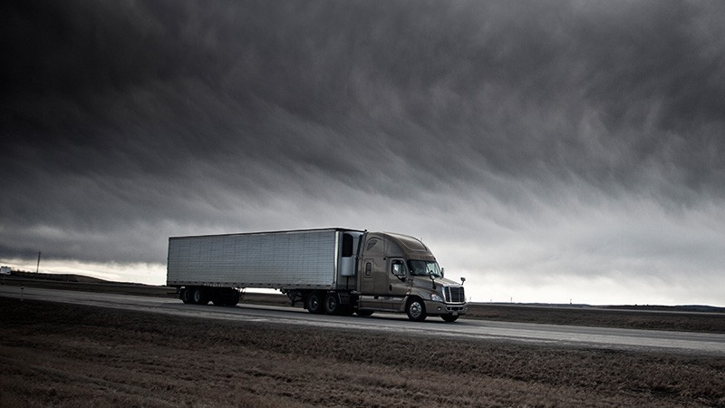 truck drives through stomry clouds