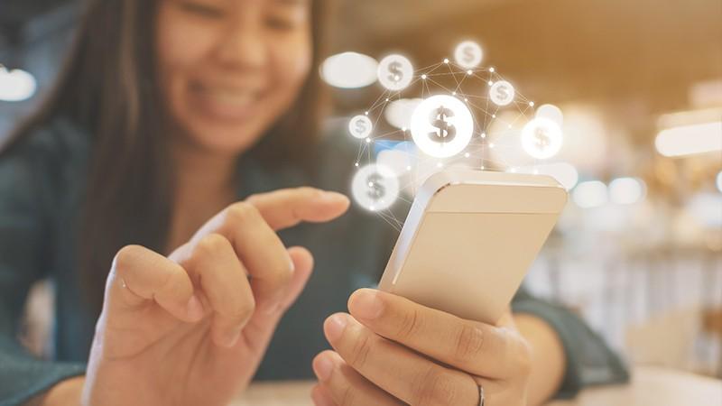 woman uses mobile to pay via p2p app