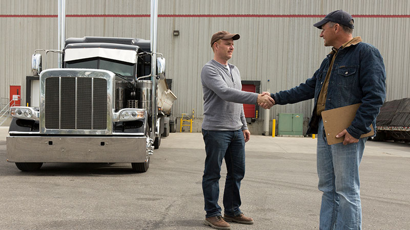 driver and manager shake hands