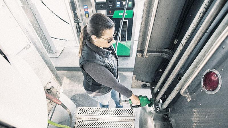 driver filling up truck fuel tank