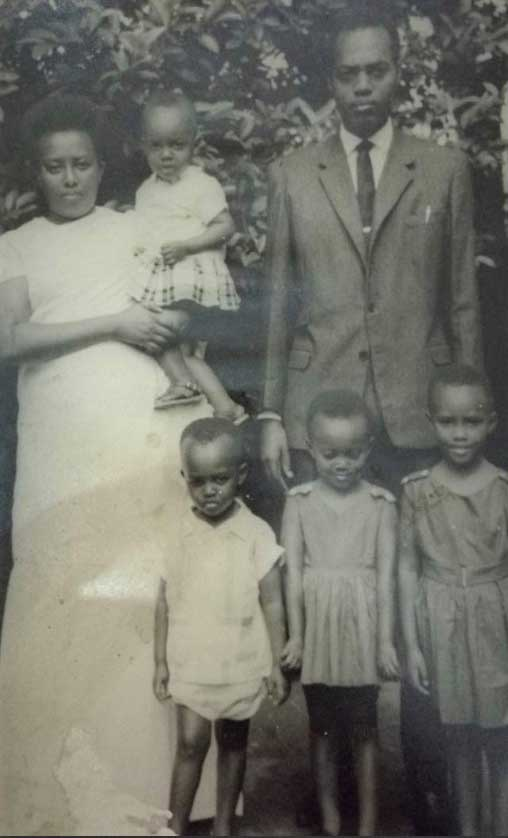 Ruvakubusa with her parents and siblings, she is in her mother's arms at age 2