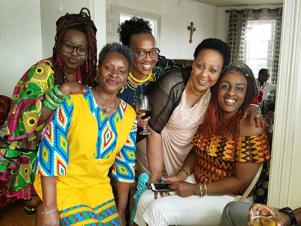 WEX's Liliane Ruvakubusa with Local Friends