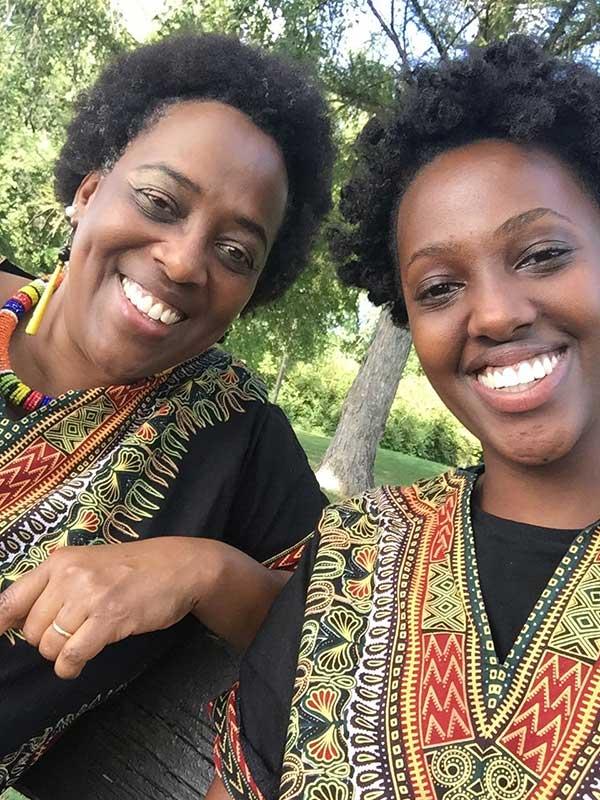 Ruvakubusa and her daughter in shirts designed and sewn by Ruvakubusa