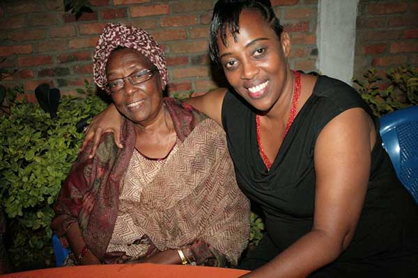 Ruvakubusa and her mother at a family birthday party in Burundi