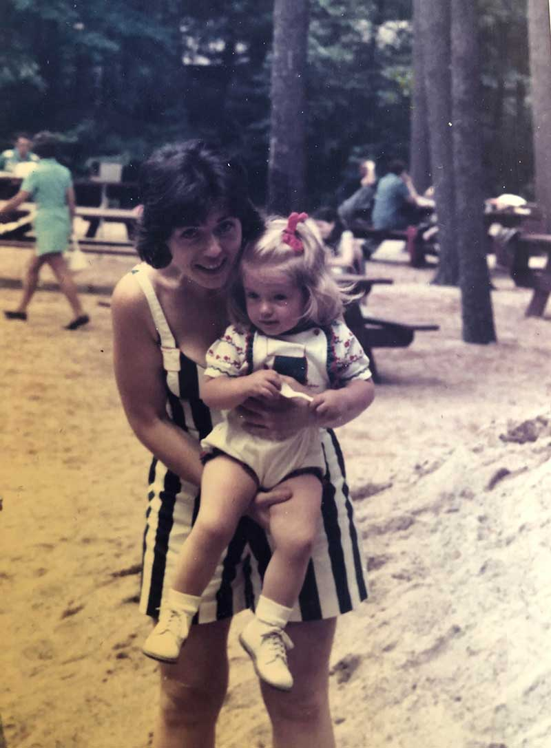 Lynn Alexander as a little girl in her mom's arms.