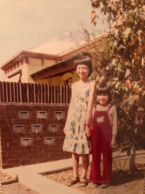 Marie Yip, on her first day of school in Australia, posing with her cousin